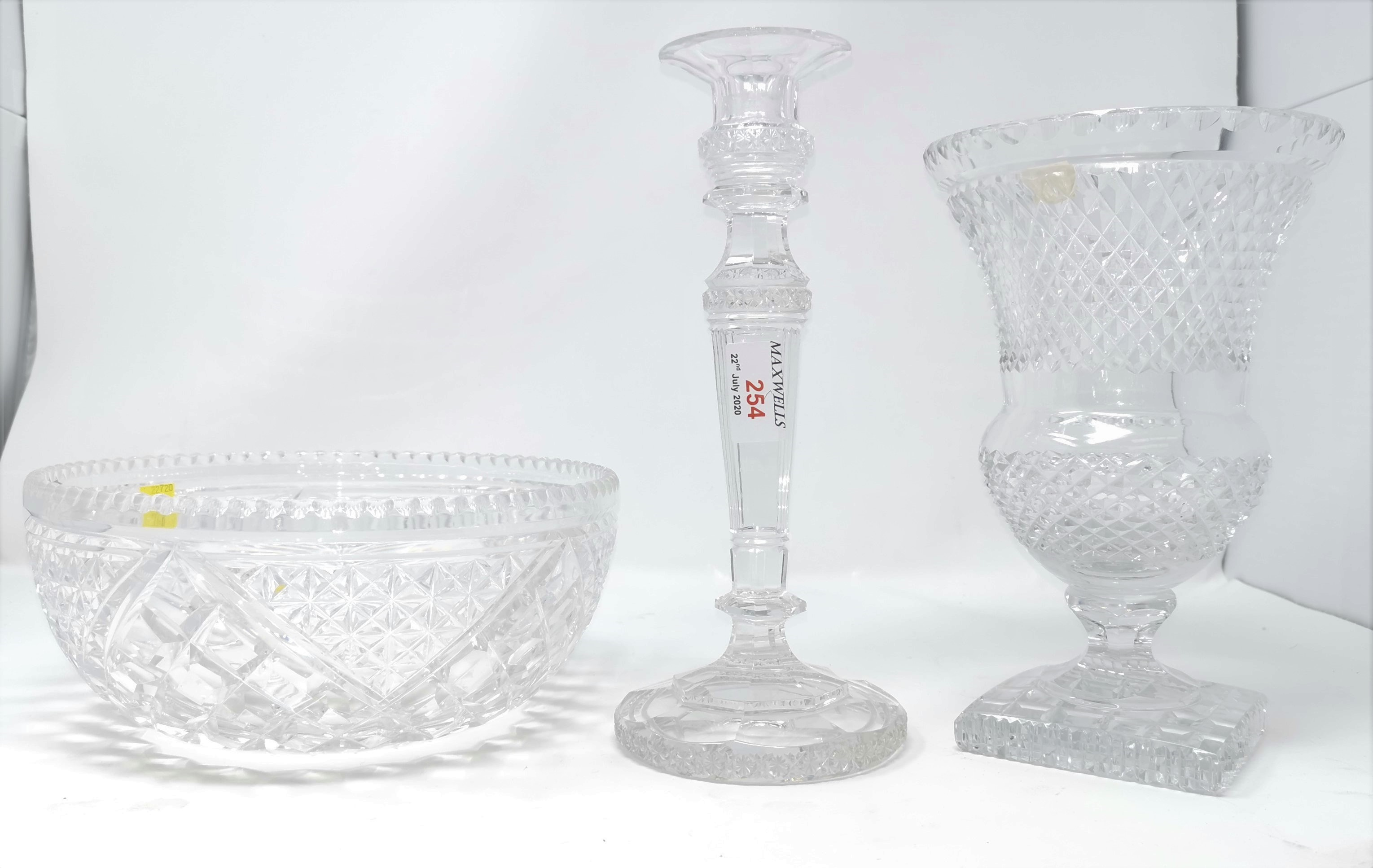 Lot 254 - A heavy cut glass candlestick with square steeped decoration; a similar celery vase and bowl