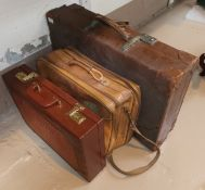 A vintage suitcase ; a tan leather overnight bag; a crocodile effect briefcase