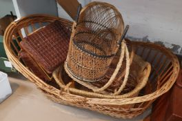 A wicker crib and other basketware; a Lloyd Loom linen box