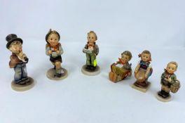 "Six Goebel Hummel figures, ""Little Helpers"" etc"