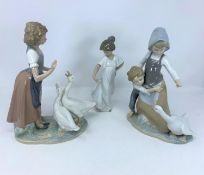 A Lladro group of young boy and girl with goose; a Nao figure of girl with two geese and a single