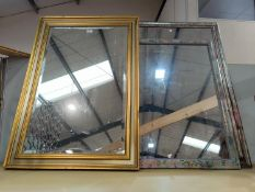 A bevelled edge wall mirror in rectangular gilt frame; 2 others