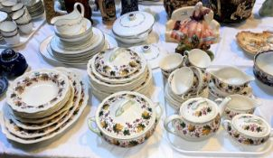 A large Royal Doulton Indian Summer D634 dinner service, including teapots, tureens etc. Another