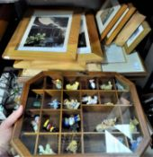 A selection of signed prints; other pictures; toy animals in display cases