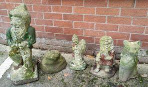 Four reconstituted stone garden ornaments: gnome; cat; etc.