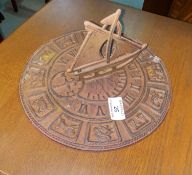 """A cast iron sundial; a cherub weather vane; a swing sign: """"Antiques & Collectibles"""""""