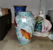 A Staffordshire dog; a pair of flower encrusted figures; other china