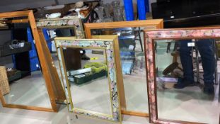 Three wall mirrors in rectangular floral frames; 2 large mirrors in pine effect frames