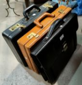 Two leather attache cases; etc.
