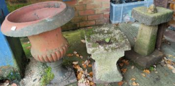 A Victorian terracotta urn; a stone birdbath