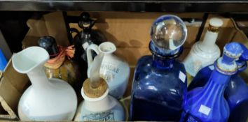 A selection of branded pottery decanters; etc.