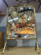 An Edwardian brass firescreen with painted mirror panel