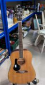 An Alvarez steel strung (strung left handed) acoustic guitar with stand & tuner
