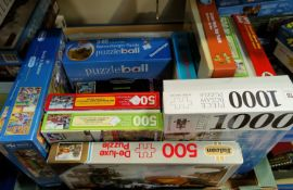 A large quantity of jigsaw puzzles