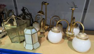 A Tiffany style conical lampshade; a brass 3 branch centre light; a chandelier; etc.