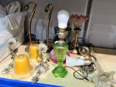 A tall glass table lamp; other table lamps