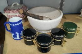 A large vintage pestle and mortar, 4 kitchen storage jars, large Victorian style soup tureen and a