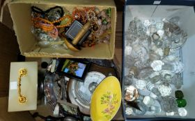 A box of lace embroidery and other linen; a selection of glass decanters/stoppers; costume