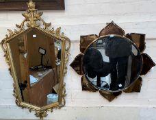 A flower head mirror in peach glass frame; a gilt framed mirror