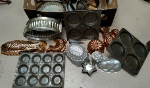 A selection of decorative china and glass; a selection of copper jelly moulds; vintage cake tins;