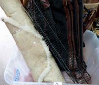 A sheepskin, case and a CD rack