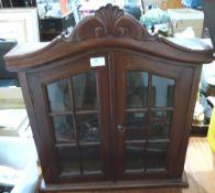 A hardwood wall display case