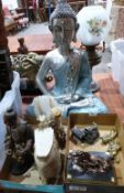 A collection of eastern carved stone and metalware, the lot to include a resinous figure of the