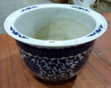 An Oriental style blue and white decorated jardiniere. 9' high