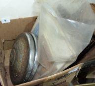 A quantity of car manuals and two Morris 1000 hubcaps
