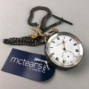 A SILVER POCKET WATCH WITH FOB CHAIN