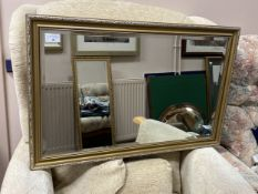 A GILT FRAMED WALL MIRROR