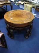 A BURR WALNUT COFFEE TABLE FITTED WITH FOUR TRIANGULAR OCCASIONAL TABLES