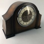 A SMITHS OAK CASED MANTEL CLOCK