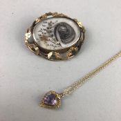 A VICTORIAN OVAL MOURNING BROOCH AND AND PENDANT ON CHAIN