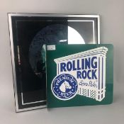 A ROLLING ROCK ALE ENAMEL SIGN ALONG WITH A MIRROR