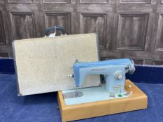 A LOT OF TWO CASED SEWING MACHINES