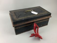 A VINTAGE LACQUERED TIN WITH BRASS HANDLE