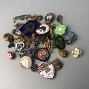 A COLLECTION OF ENAMEL BADGES