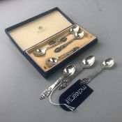 A SET OF SEVEN SILVER COFFEE SPOONS BY GEORG JENSEN
