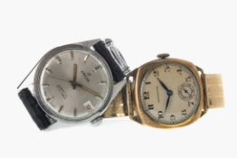 A GENTLEMAN'S ENICAR STAINLESS STEEL AUTOMATIC WATCH AND A HENDERSONS GOLD PLATED MANUAL WIND WATCH