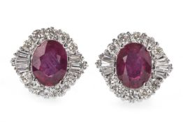 A PAIR OF TREATED RUBY AND DIAMOND EARRINGS