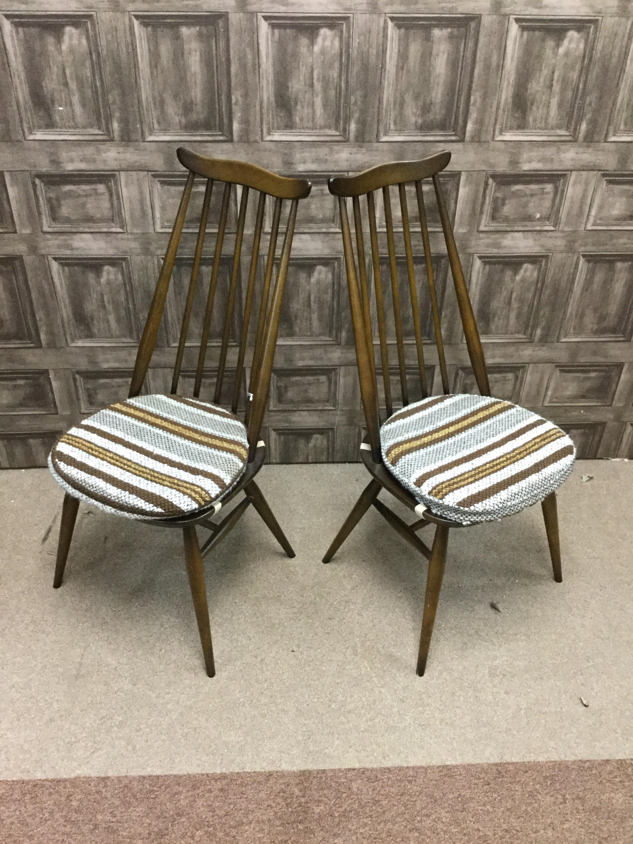 Lot 1462 - A SET OF FOUR ERCOL SPINDLE BACKED DINING CHAIRS
