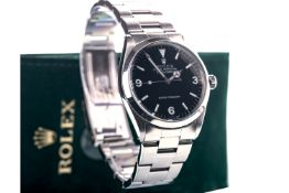 A GENTLEMAN'S ROLEX OYSTER PERPETUAL EXPLORER SUPER PRECISION STAINLESS STEEL AUTOMATIC WRIST WATCH