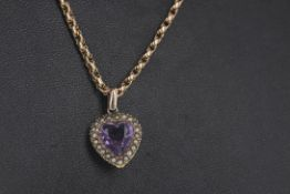 A PURPLE GEM SET AND SEED PEARL PENDANT ON CHAIN