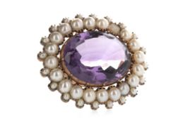 A PURPLE GEM SET AND PEARL BROOCH