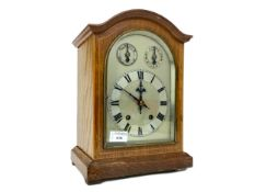 AN EDWARDIAN OAK MANTEL CLOCK
