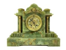 A LATE VICTORIAN GILT AND ONYX MANTEL CLOCK