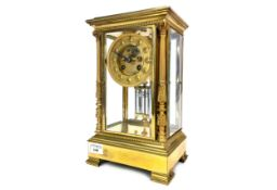 A EARLY 20TH CENTURY GILTMETAL MANTEL CLOCK