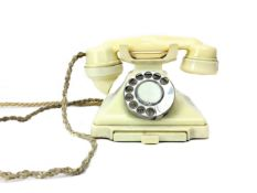 A VINTAGE CREAM BAKELITE TELEPHONE