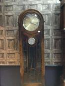 AN EARLY 20TH CENTURY OAK LONGCASE CLOCK